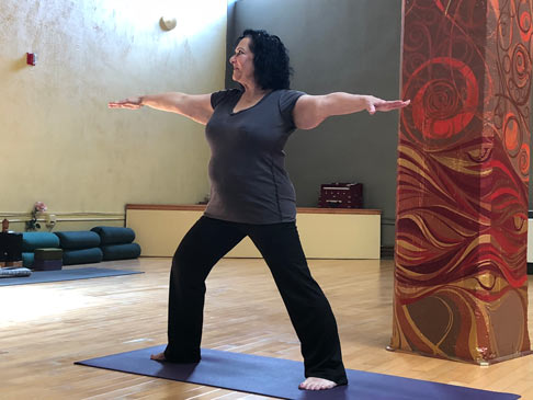 Patti Berman enjoying yoga. Something she couldn't do before working with Knekoh.
